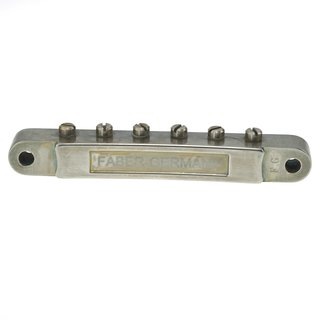 ABRM-BA        ABRM Bridge, Fits 4mm studs, Aged Nickel, Brass saddles natural